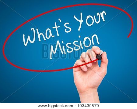 Man Hand writing What's Your Mission with marker on transparent wipe board.