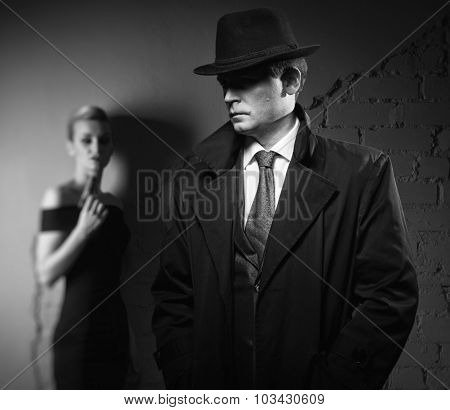 Detective Man And Dangerous Woman With A Gun