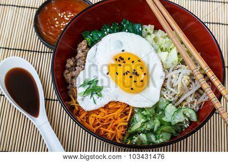 Korean cuisine, beef  Bibimbap in red bowl
