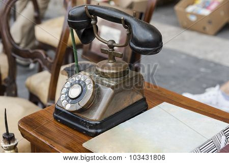 old black telephone brass and copper on wood table