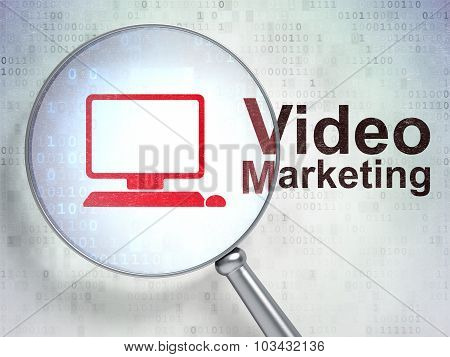 Finance concept: Computer Pc and Video Marketing with optical glass