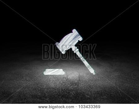 Law concept: Gavel in grunge dark room