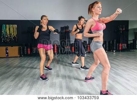 Women in a boxing class training punch