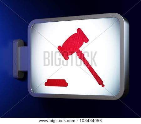 Law concept: Gavel on billboard background