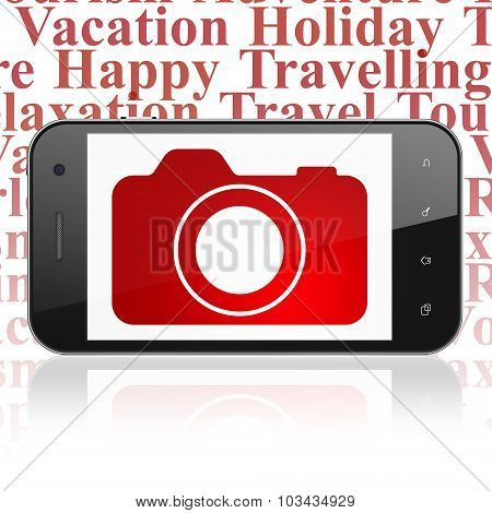 Vacation concept: Smartphone with Photo Camera on display