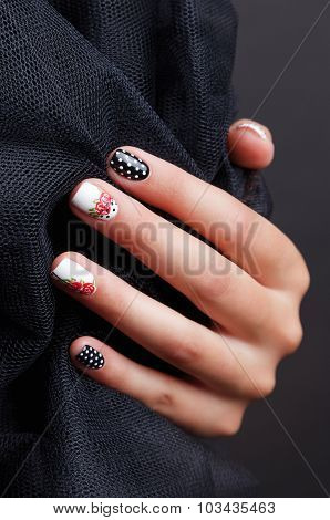 Close-up Of Trendy Spotted Nails