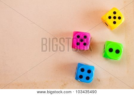 Dice On The Cardboard Background