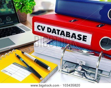 CV Database on Red Ring Binder. Blurred, Toned Image.