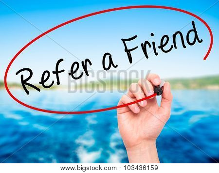 Man Hand writing Refer a Friend with black marker on visual screen.