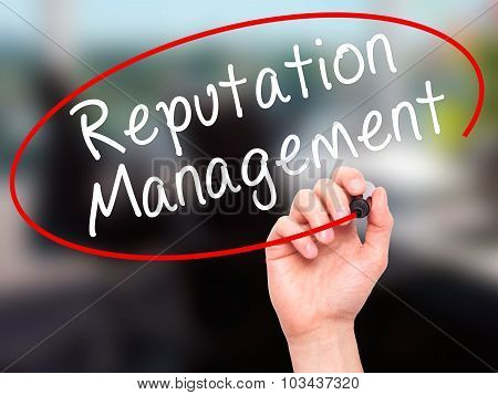 Man Hand writing Reputation Management with black marker on visual screen.