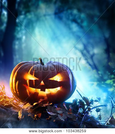 Halloween Pumpkin In A Spooky Forest At Night - Scary Scene