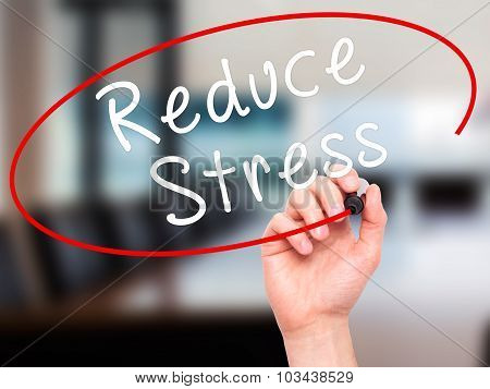 Man Hand writing Reduce Stress with black marker on visual screen.