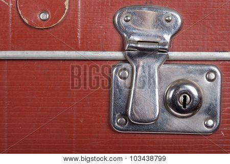 Lock of an old brown suitcase