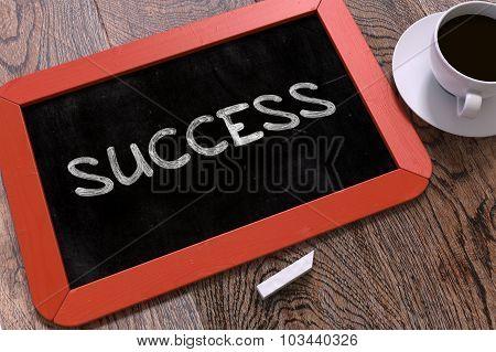 Success Handwritten on Chalkboard.