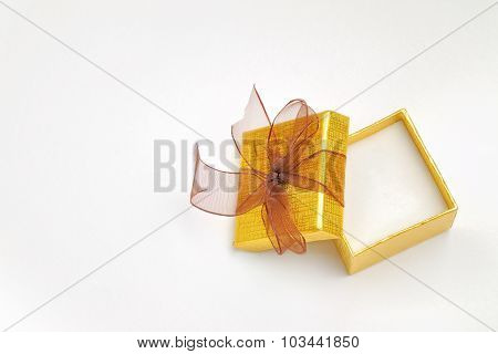 Open Golden Gift Box With Brown Tie Top View