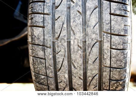 Close up of a car dirty tire.