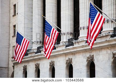 NEW YORK CITY, USA - SEPTEMBER, 2014: Flags of the USA outside the New York Stock Exchange