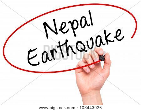 Man Hand writing Nepal Earthquake with black marker on visual screen.