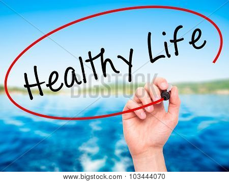 Man Hand writing Healthy Life black marker on visual screen