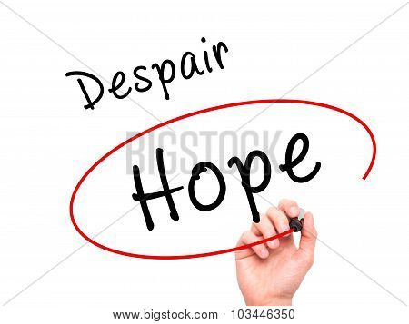 Man Hand writing and choosing Hope instead of Despair with black marker on visual screen.