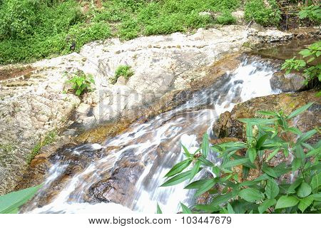 Small Waterfall Or Cascade In The Forest