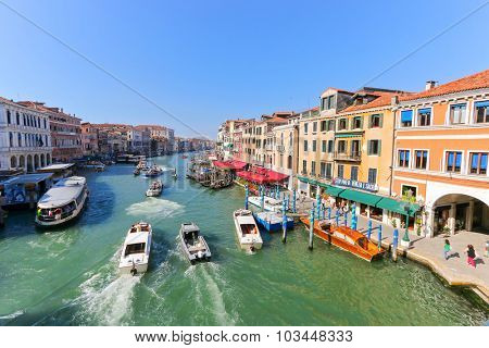 VENICE, ITALY - SEPTEMBER 2014 : Gondolas, public boats, water taxis and other private boats on the Grand Canal in Venice, Italy on September 15, 2014. Venice is a city of canals
