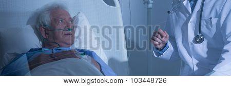 Elder Patient Looking At Doctor