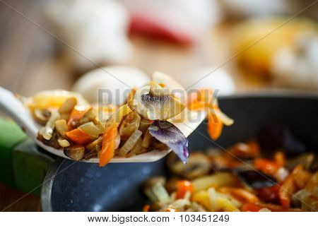 Fried Mushrooms With Peppers And Onions