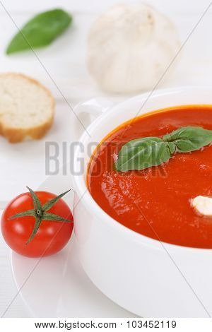 Tomato Soup With Tomatoes And Baguette In Bowl