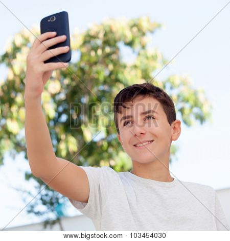 Teen boy getting a photo with the phone in the street