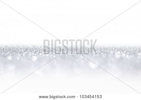 Silver glitter background with beautiful bright bokeh lights and white copy space