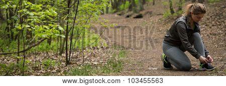 Sportive Female Preparing To Run