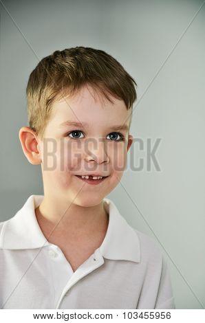 Little Boy Looking Slyly. Vertical Portrait