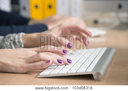 Female fingers typing on keyboard