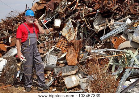 Recycling Industry, Heap Of Old Metal And Worker