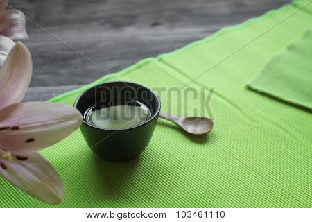 Asian Tea Cup And Spa Settings On Wooden Board