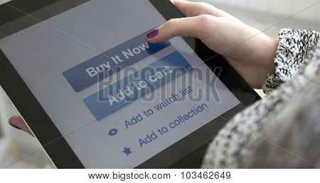 Internet shopping Female fingers clicking on BUY button