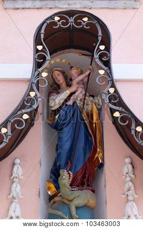 LJUBLJANA, SLOVENIA - JUNE 30: Virgin Mary with baby Jesus, statue on the house facade in Ljubljana, Slovenia on June 30, 2015