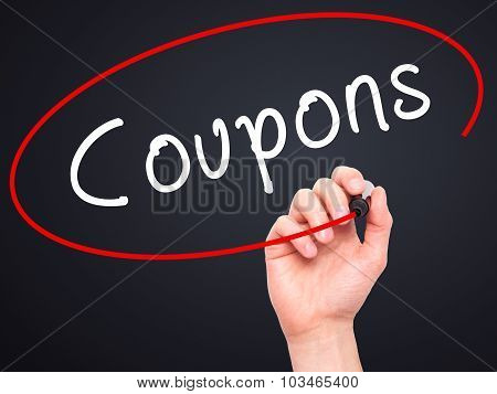 Man Hand writing Coupons black marker on visual screen.