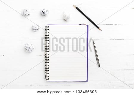 Notepad And Crumpled Paper