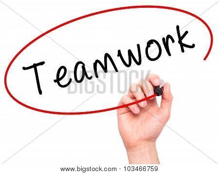 Man Hand writing Teamwork with black marker on visual screen.