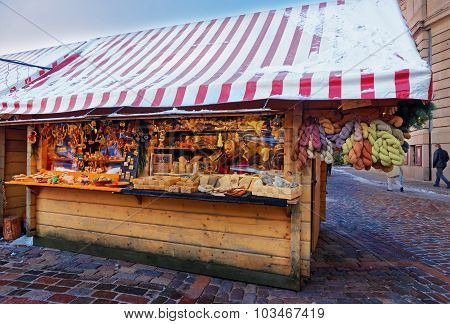 Christmas Market Stall With Natural Wooden Souvenirs For Sale