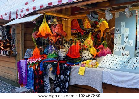 European Christmas Market Stall In Riga With Handmade Goods For Sale