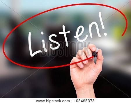 Man Hand writing Listen with black marker on visual screen.