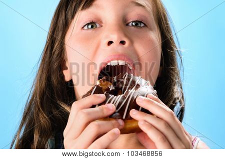Portrait of adorable cute girl kid with donut