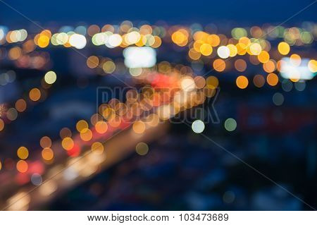 Blurred bokeh city road curved at night
