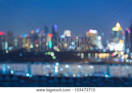 City light at night, abstract blurred bokeh background
