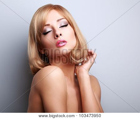 Beautiful Blond Woman With Clean Heathy Skin Have Closed Eyes And Touching Hair