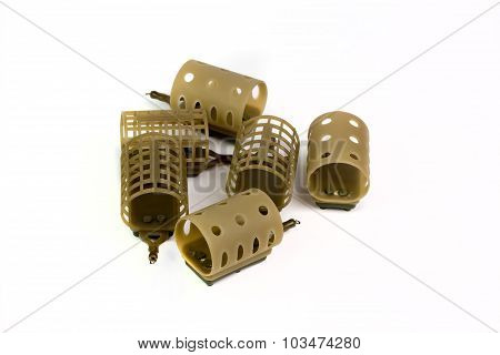 Six Feeders For Fishing On A White Background
