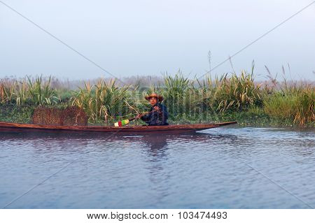 Intha man in wooden boat, Myanmar